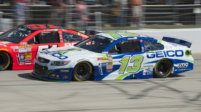 The Geico NASCAR car number 15 side by side trying to pass another car