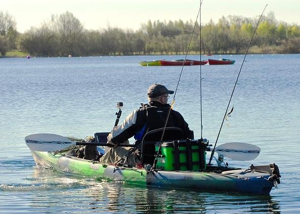 fisherman in his fishing kayak