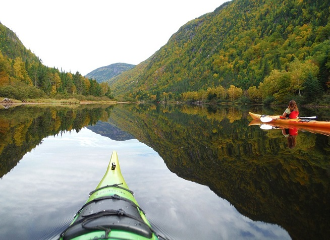 kayaking on a picturesque mountain lake
