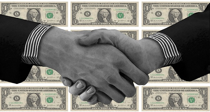partners shaking hands and making money